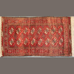 An Afghan rug size approximately 3ft. 10in. x 7ft. 5in.