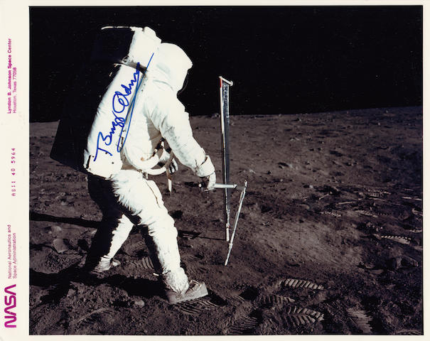 ALDRIN WORKS ON THE MOON. Color photograph, 8 x 10 inches.