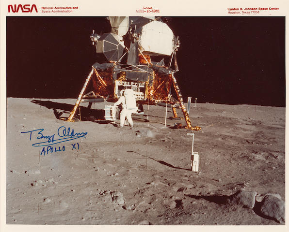 EAGLE ON THE MOON. Color photograph, 8 x 10 inches. NASA identification number and caption at top margin and on verso.