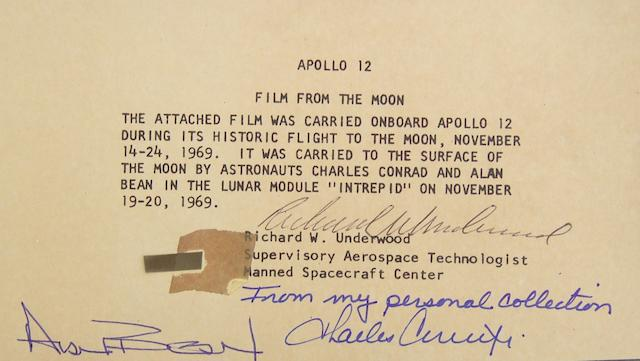 FLOWN APOLLO XII FILM SEGMENT. 70mm Hasselblad camera film segment, ½ x ¼ inch.  Placed onto a certificate issued and signed by Richard W. Underwood, Supervisory Aerospace Technologist at the Manned Space Center.