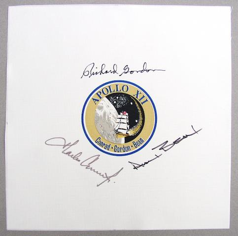 APOLLO 12 BETA EMBLEM-CREW SIGNED. Beta cloth crew emblem, 9 inches square.