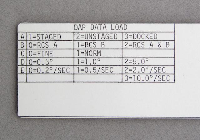 SIGNED TRAINING CUE CARD. DPS, APS, RCS, DAP DATA LOAD.  Apollo 13 3/20/70.  NASA/MSC.  4½ x 10 inches having two notched-out sections.  With four Velcro place holders on the reverse side. Certification inscription by FRED HAISE.