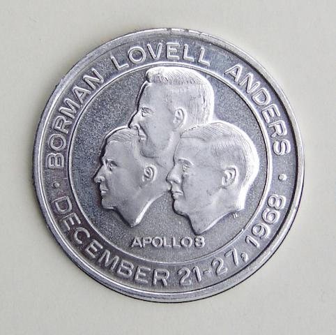 FLOWN MANNED FLIGHT AWARENESS MEDALLION. Apollo 8 Manned Flight Awareness (MFA) medallion,