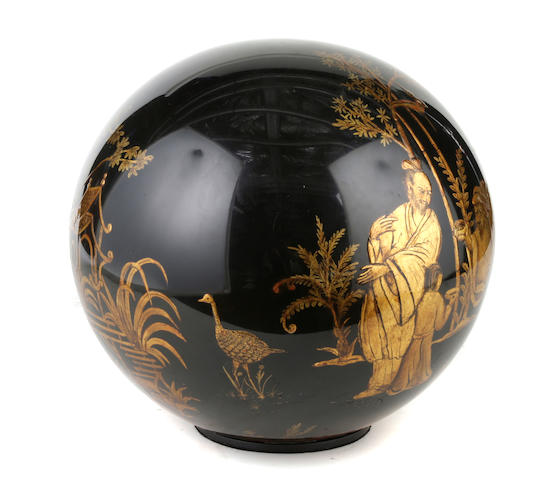 A contemporary chinoiserie gold and black lacquered sphere
