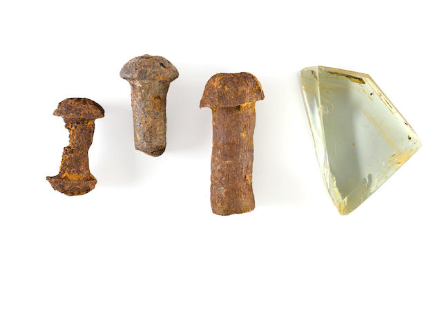 [R.M.S. Titanic] Three rivets and one piece of porthole glass<BR /> circa 1911 3-1/2 in. long (the largest rivet); 2-3/4 x 3-3/4 in. (the piece of glass) 4