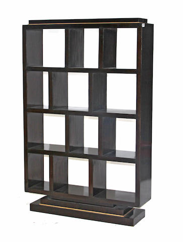 A contemporary ebonized hard wood étagère