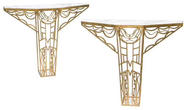 A pair of French Art Deco style gilt wrought iron and marble consoles in the manner of Edgar Brandt, adapted by Tony Duquette