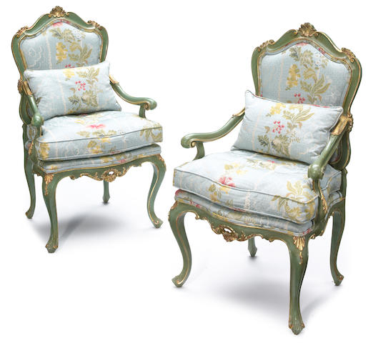 A pair of Venetian Rococo style parcel gilt and green painted wood open armchairs