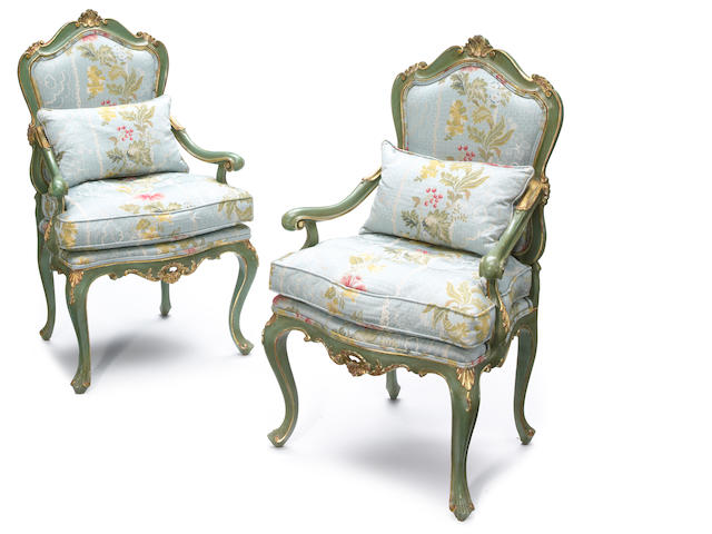 A pair of Venetian Rococo style parcel gilt and green painted open armchairs