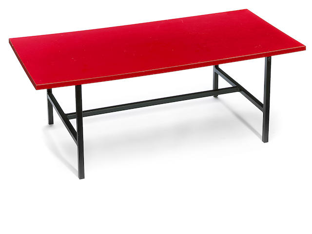 An Alain Richard laminate and steel low table circa 1959