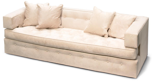 A Tony Duquette suede upholstered architectural sofa