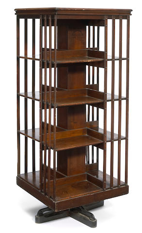 An American Victorian mixed wood four tier revolving bookcase