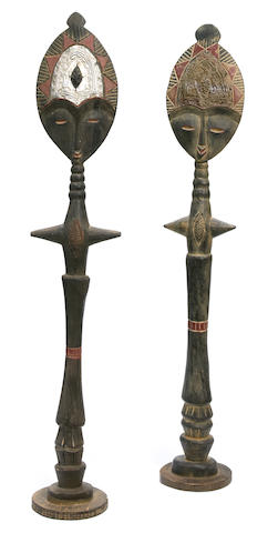 A pair of West African polychromed wood tribal figures 20th Century