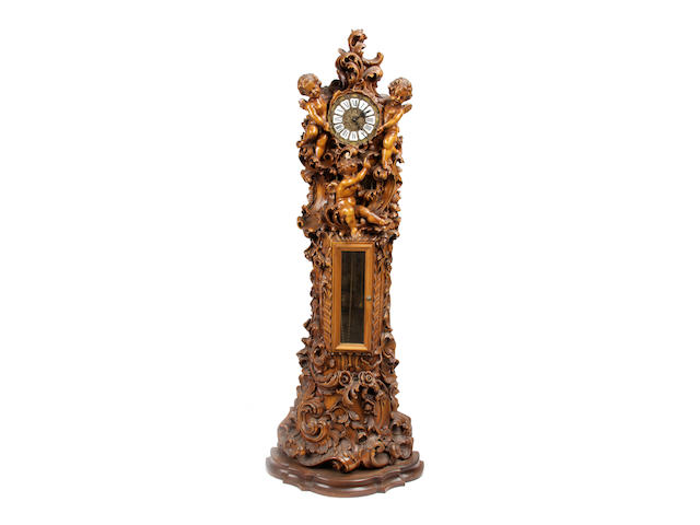 A German Rococo Revival carved wood tallcase clock
