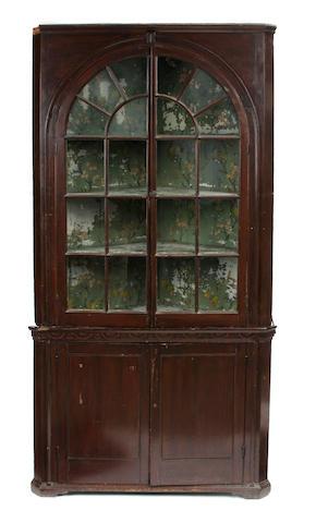 An American glazed door corner cupboard