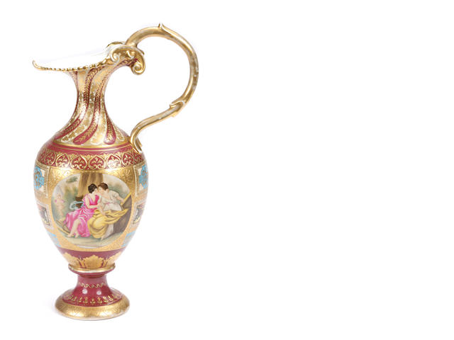 Two Vienna style parcel gilt paint decorated ewers