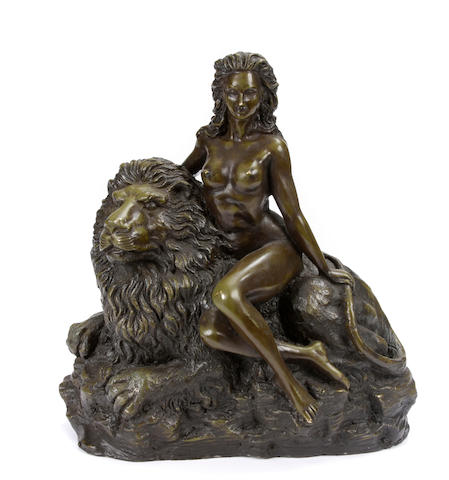 A patinated bronze figural group of woman and a lion
