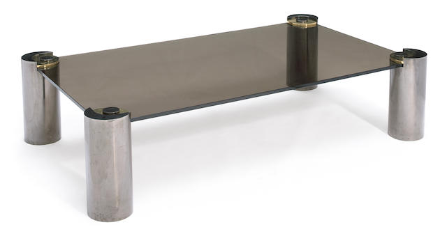 A large Karl Springer smoked glass, chromed metal and brass coffee table 1980s