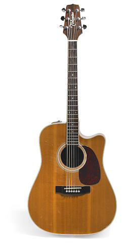 A Jerry Garcia stage-played, acoustic guitar made by Takamine, ca. 1985.  Includes case, Garcia's strap, pick and 2 discs, featuring the guitar on the covers.