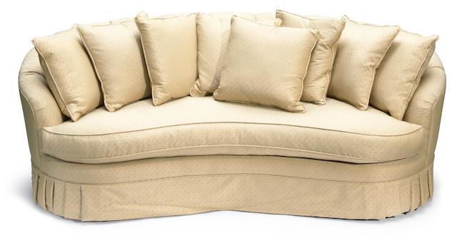 A Tony Duquette brocade upholstered reniform sofa