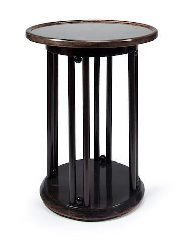A Josef Hoffmann stained and bent beechwood glass-topped Fledermaus table probably produced by J. & J. Kohn, circa 1904