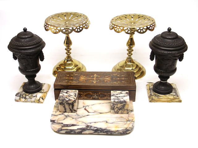 An assembled three piece variegated marble and patinated metal desk set, pair of reticulated brass kettle stands and an inlaid glove box late 19th/early 20th century