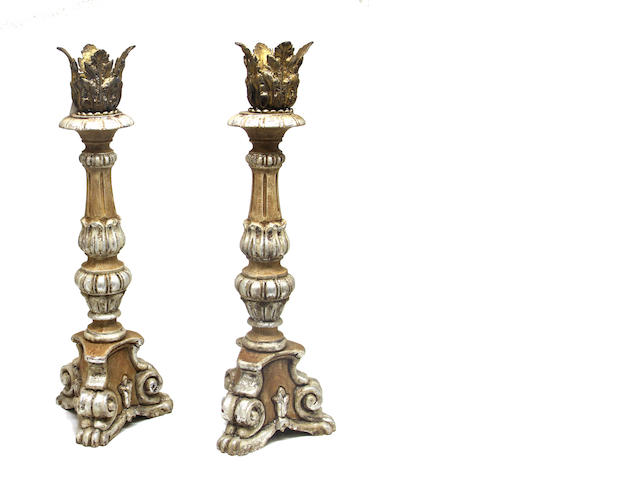 A pair of Baroque style rot iron table lamps, pair of Baroque style composition pricket candlesticks, and a Baroque style parcel gilt standard late 20th century