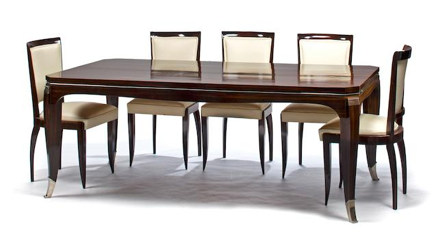 A French Art Deco rosewood dining table and six side chairs  attributed to Maurice Rinck, 1930's