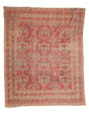 An Oushak carpet  size approximately 10ft. 11in. x 12ft. 11in.