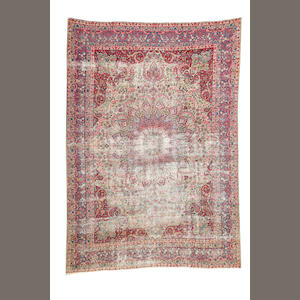 A Kerman carpet  size approximately 8ft. 9in. x 11ft. 8in.