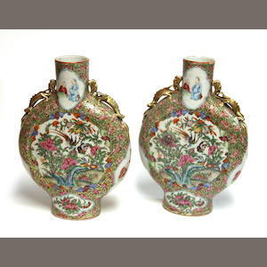 A pair of famille rose enameled porcelain moon flaxks executed in the Rose Meallion palette Late 19th century