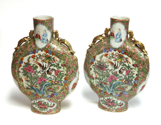 A pair of famille rose enameled porcelain moon flasks executed in the Rose Medallion palette Late 19th century