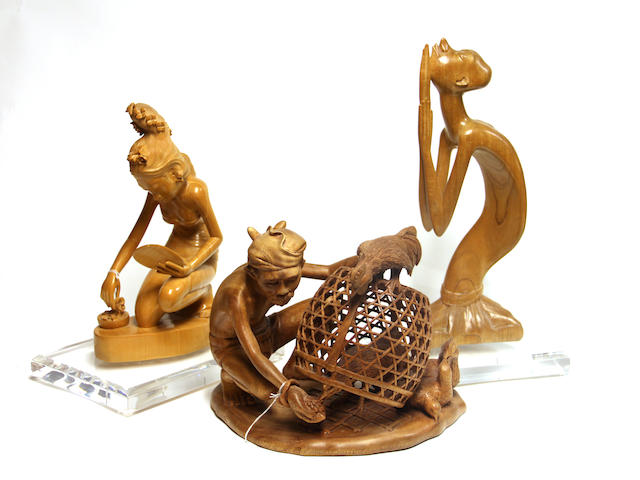 A group of three Balinese wood carvings 20th century