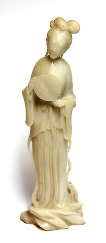 A Chinese carved white soapstone figure of a beauty