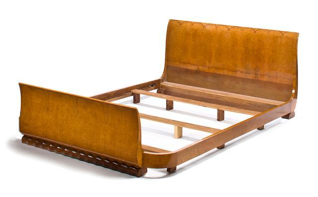 A Jules Leleu fruitwood bed circa 1928