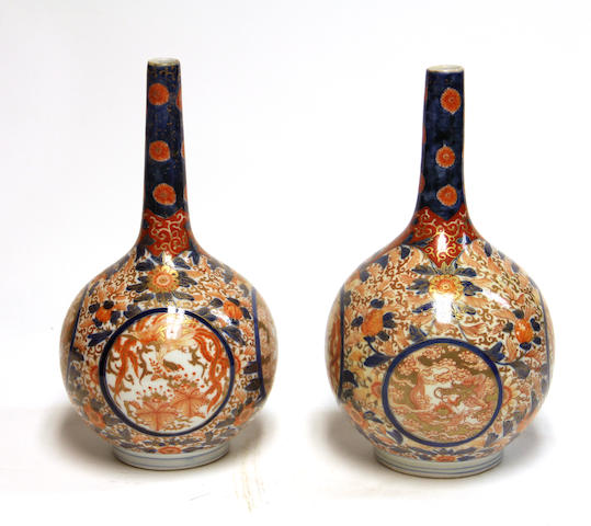 A pair of Imari porcelain stick-neck vases Meiji/Taisho period