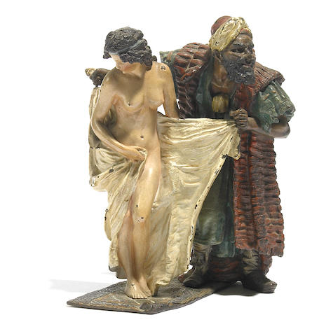 A Franz Bergman cold painted bronze figural group of a slave trader and a maiden on a carpet circa 1900
