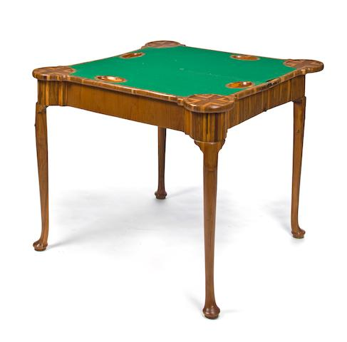 A George I calamander and cocus wood concertina action games table second quarter 18th century