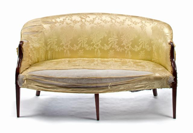 A George III mahogany settee in the Hepplewhite taste late 18th century