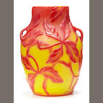 A Tiffany red and yellow two-handled cameo glass vase