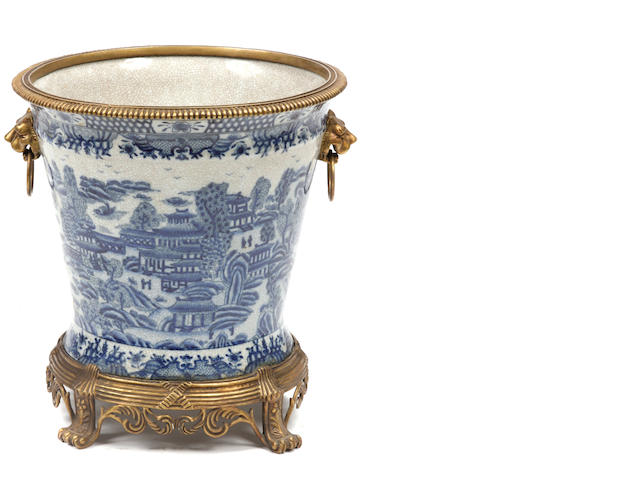 A pair of Chinese blue and white gilt bronze mounted cache pots