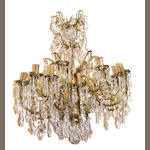 A Louis XV style gilt bronze and cut glass ten light chandelier