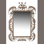 A pair of Rococo style wrought iron and tole mirrors