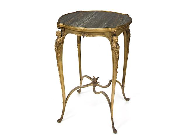A Louis XV gilt bronze gueridon with a green variegated marble top Zwiener Jansen Successeur fourth quarter 19th century