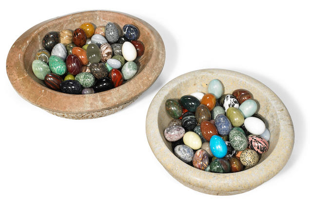 A collection of 120 hardstone and semiprecious stone eggs and two marble basins