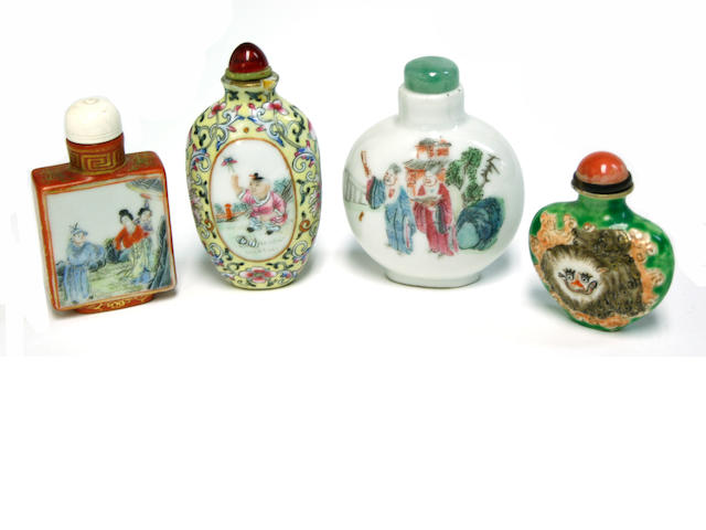 A group of four polychrome enameled porcelain snuff bottles