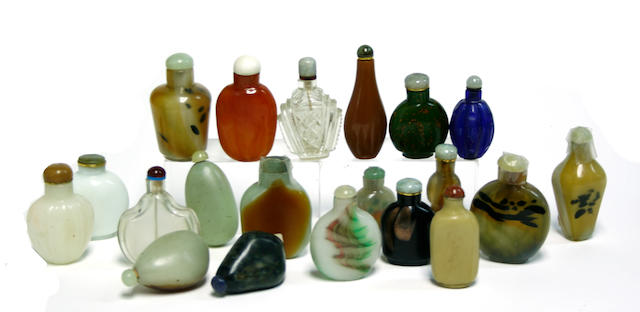 A group of nineteen glass bottles