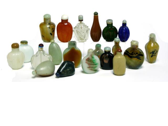 A group of nineteen glass bottles