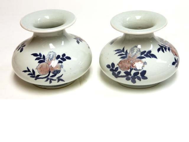 A pair of porcelain vases with underglazed blue and copper red decoration