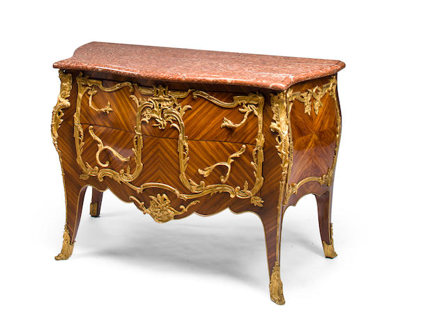 A magnificent Louis XV style parquetry inlaid kingwood commode
